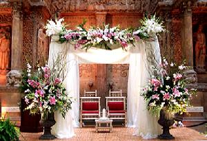 Flower Arrangements For The Altar Tall Ivy Topiaries With Gardenias White Silk Pew Bows Aisle Candelabra Tied Flowers And Fernsall Coordinate